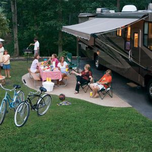 Family sitting at RV site