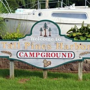 Welcome sign at Tall Pines Harbor Campground