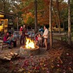 family around campfire at Williamsburg KOA