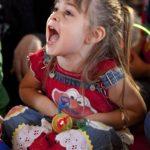 little girl wearing elmo tshirt