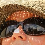 woman wearing sunglasses and sunhat