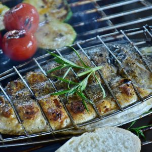 fish grilled on campfire