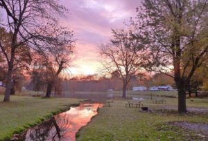 sunset with campsites in the background