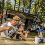 man and young girl sitting at picnic table at Virginia Beach KOA