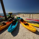 kayaks on a beach at cherrystone family camping resort