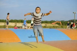 young boy on jumping pillow